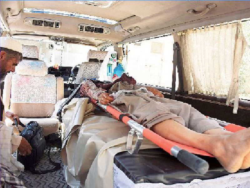 The body of a de-miner lies in an ambulance at a hospital in Kandahar, Afghanistan.