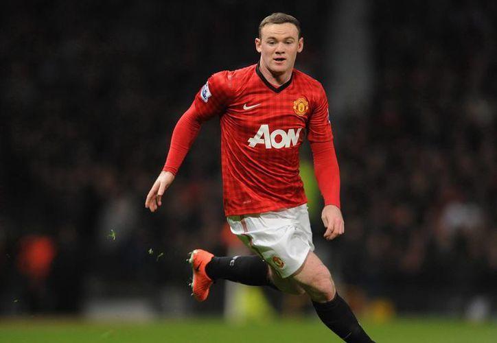 A Rooney le restan dos años de contrato con el Manchester United. (EFE)