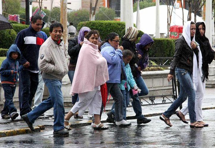 El frente frío 14 que afecta a la mayor parte de México causó la muerte de cinco personas. En la Península de Yucatán seguirá el mal tiempo. (Archivo SIPSE)