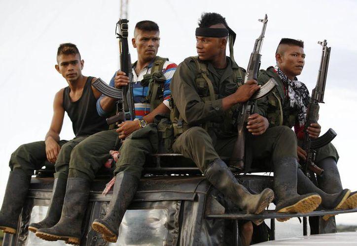 Colombia llegó a un acuerdo con los miembros de las FARC para mantener la paz en el país y terminar con la lucha entre ambos. (AP/Ricardo Mazalan)