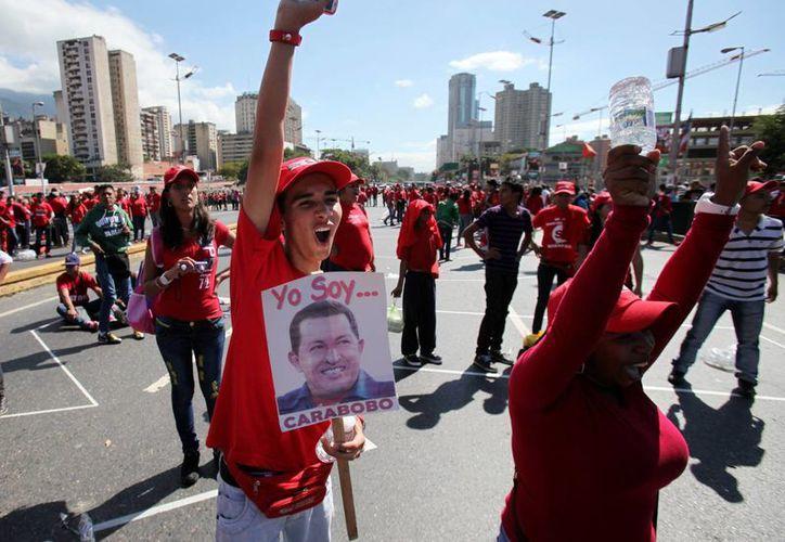 Simpatizantes del presidente Chávez en una manifestación en Caracas. (Agencias)