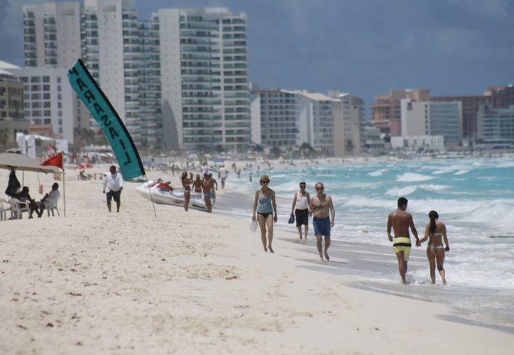 """La marca Cancún estará en las latas de los refrescos Coca Cola Light y Coca Cola Zero y llevará la leyenda en portugués """"Quanto mais Cancún... melhor"""" (Cuanto más Cancún... mejor). (Jesús Tijerina/SIPSE)"""