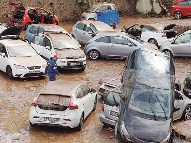 Damaged cars are strewn across an open parking area in northern Athens. (AP)
