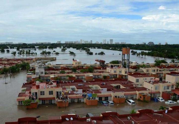 El fenómeno meteorológico dejó daños en 13 mil viviendas. (Archivo/AP)
