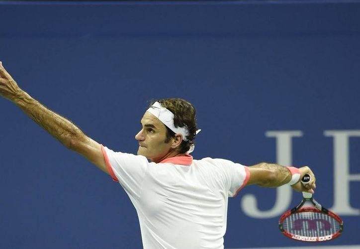 Roger Federer eliminó a Richard Gasquet y ahora enfrentará a Stanislas Wawrinka en lo que será una semifinal suiza en el Abierto de EU. (EFE)