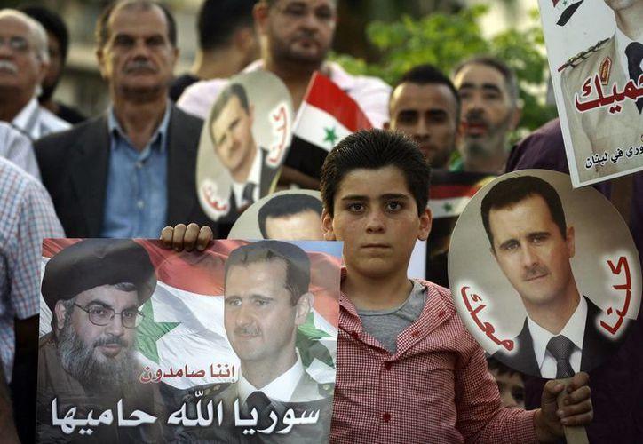 El presidente de Siria, Bashar al-Assad dijo que las amenazas no hacen más que aumentar su compromiso con sus principios y su independencia. (Archivo/EFE)