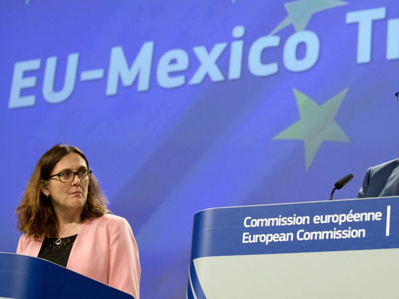 The European Trade Commissioner, Cecilia Malmstrom, left, and the European Commissioner for Agriculture, Phil Hogan, participate in a press conference at the EU headquarters in Brussels.