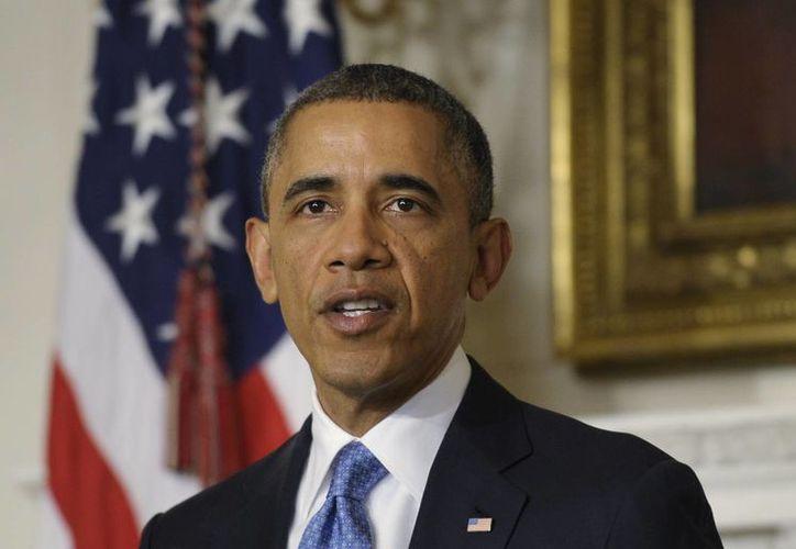 Disputan ser sede de la biblioteca de Obama El presidente Barack Obama, ayer durante un discurso sobre el programa nuclear iraní, en el comedor de la Casa Blanca. (Agencias)