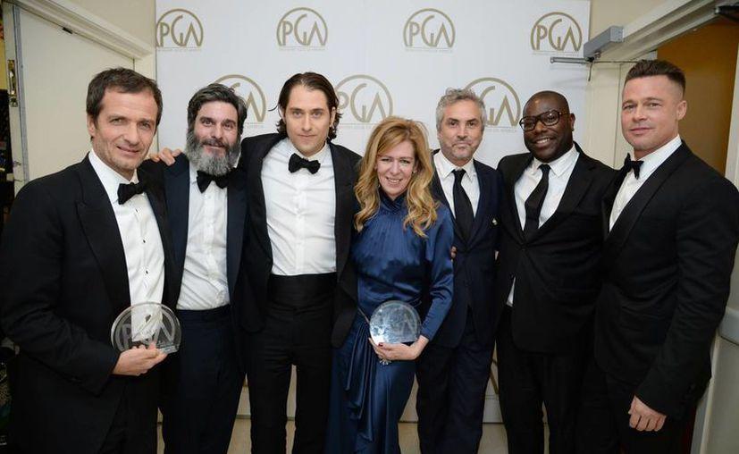 En la foto los directores David Heyman, Anthony Katagas, Jeremy Kleiner, Dede Gardner, Alfonso Cuaron, Steve McQueen y Brad Pitt. (Agencias)