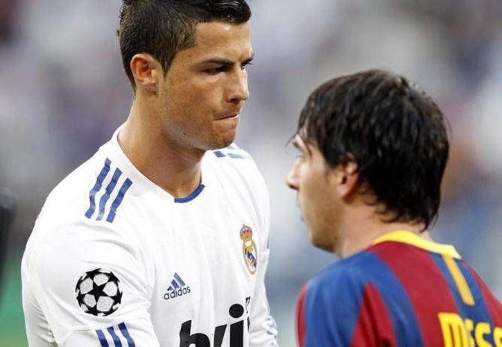 El Presodente de la FIFA dejó ver en semanas pasadas su preferencia por Messi. (Foto: Agencias)