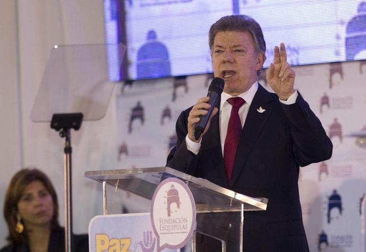 El presidente Santos asegura que van contra las cabecillas del Clan Usuga, responsable de atentados y hechos violentos en varias partes de Colombia. (AP)
