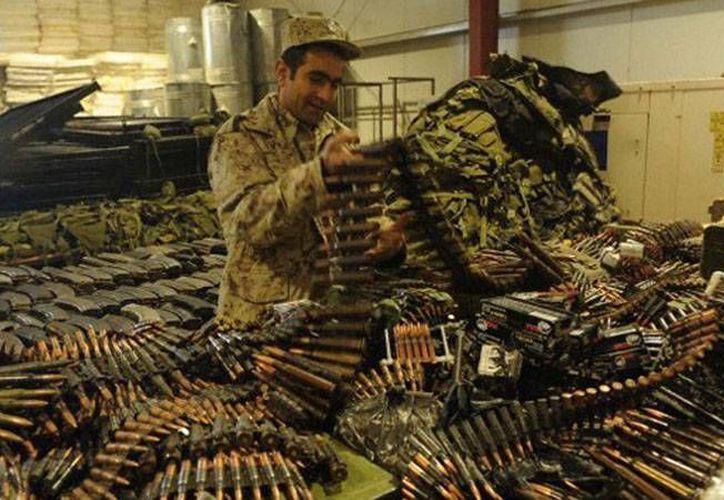 EU planea retirar de Afganistán, a través de Rusia, apenas entre el uno y dos por ciento del arsenal que utilizó para la guerra. (RT)
