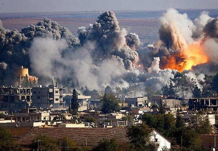 La revista estadounidense no descarta la opción de un enfrentamiento entre las fuerzas armadas de Rusia y de EE.UU, en territorio de Siria.(Archivo/AP)