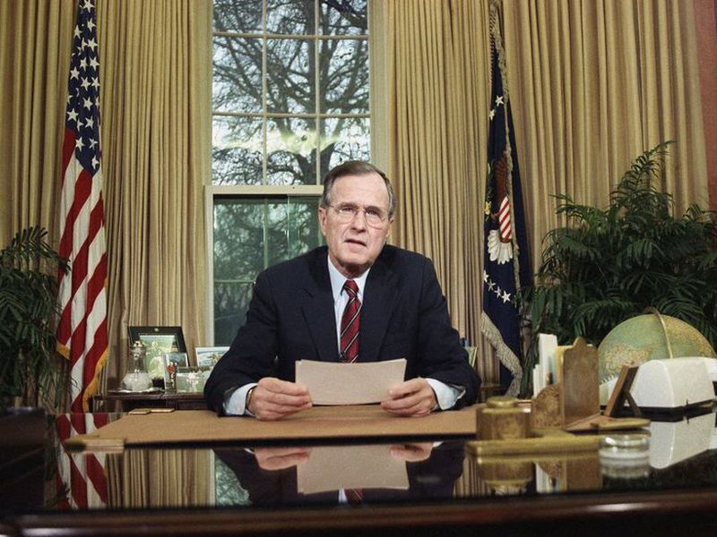 President George H.W. Bush addresses the nation on television from the Oval Office in Washington.