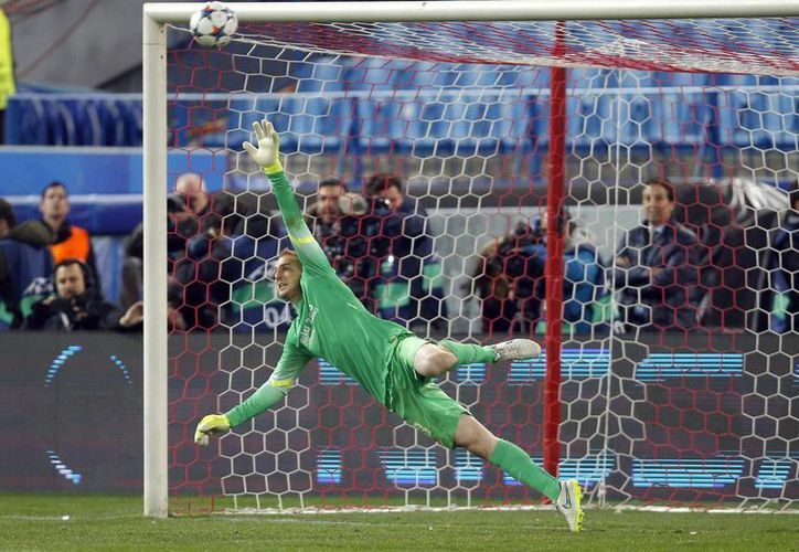 Stefan Kiessling falló el último tiro penal de Bayer Leverkusen ante Oblak, portero de Atlético de Madrid, con lo cual se decretó la eliminación del cuador alemán y el avance del español a cuartos de final en la UEFA Champions League. (Foto: AP)