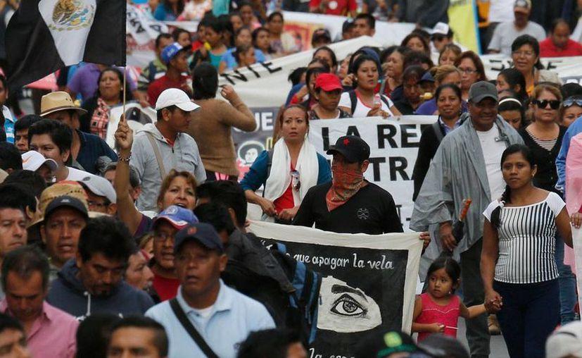 'Hoy en día somos un país de libertades', señala el Gobierno mexicano. En la imagen, una marcha de maestros de la CNTE en la ciudad de México, el 22 de agosto de 2016. (AP/Marco Ugarte)