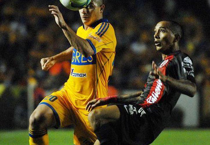 El duelo más atractivo de la fecha cinco del Clausura 2013 fue el de Tigres y Xolos que terminó en empate 2-2. (Notimex)