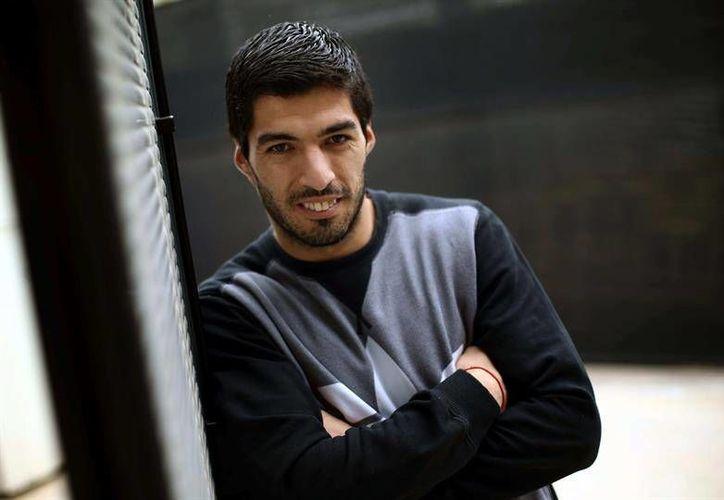 Luis Suárez asegurá que uno de los secretos de este Barza es la gran relación existente entre todos los jugadores. (Imágenes de EFE)