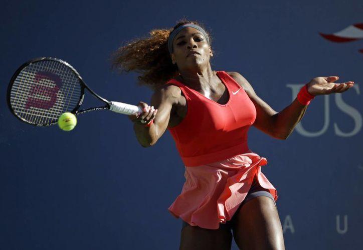 Serena no se llevó fácil el encuentro con la china Li Na, quien sacó fuerzas de donde pudo para responder a la norteamericana. (Agencias).