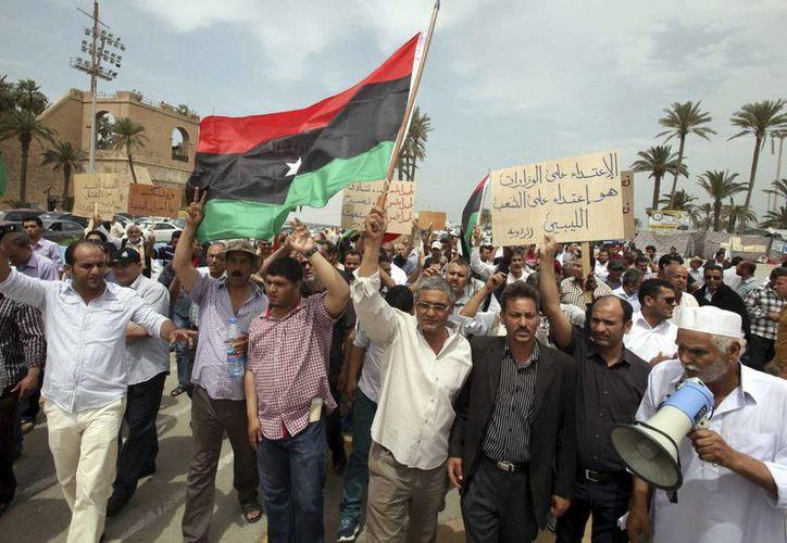 Manifestantes piden la expulsión de las milicias de Trípoli. (EFE/Archivo)