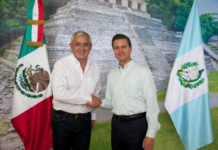Peña Nieto, acompañado por el presidente guatemalteco Otto Pérez Molina, indicó que buscará hacer de la frontera sur una zona inclusiva y competitiva. (Presidencia de México)