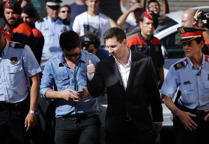 Si Messi y su padre son declarados culpables pueden multarlos al 150% del monto defraudado y dictarles prisión. (EFE)