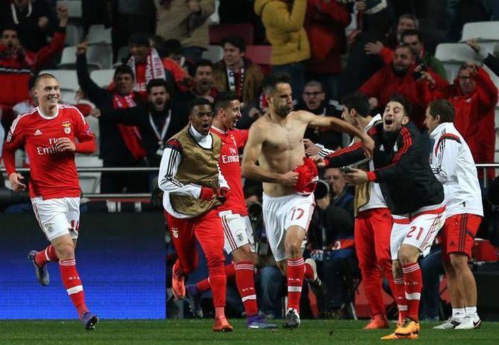 La Champios League regresó de una larga pausa con la ida de los octavos de final, en uno de los cuales el Benfica venció por la mínima al Zenit de San Petersburgo. (Imágenes de AP)