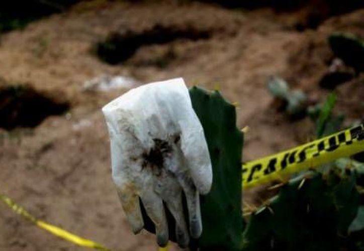La secretaria de Seguridad Pública de Morelos aseguró que en toda la entidad se llevan a cabo operativos en busca de más fosas clandestinas.(Archivo/Agencias)