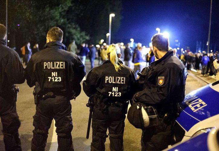 La policía informó que fueron arrestados cuatro personas. (Foto: Agencias)