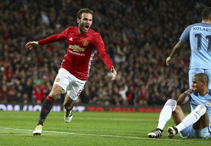 El United aprovechó un descuido defensivo al minuto 54, para anotar el único gol del encuentro, el cual le dio el pase a los Cuartos del torneo.En la foto, Juan Mata celebra la anotación.(Dave Thompson/AP)
