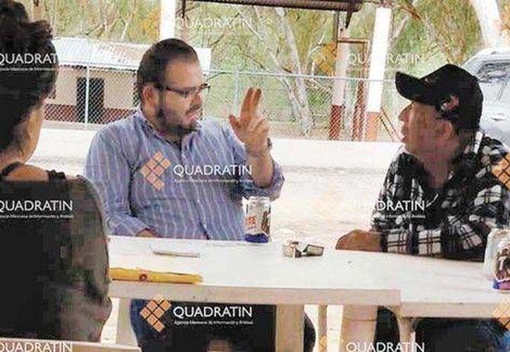 Rodrigo Vallejo y Servando Gómez (a) 'La Tut' durante la reunión en la que fueron grabados en video. (Milenio)