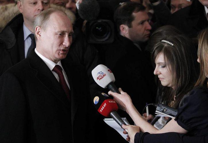 l presidente Vladimir Putin recibió este sábado autorización del parlamento ruso para usar la fuerza militar de su país en Ucrania. (Archivo/EFE)