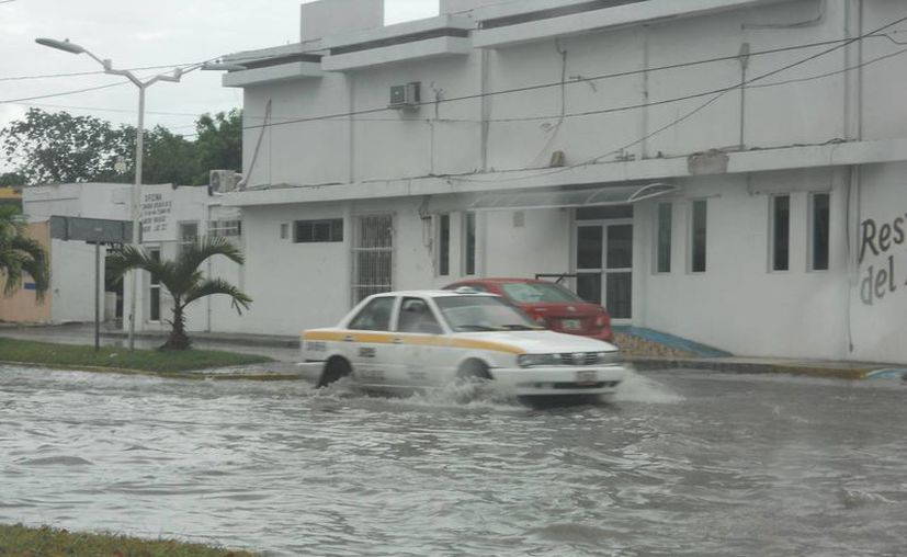 Precipitaciones pluviales cercanas a 50 milímetros amenazan diversos puntos de la ciudad. (Archivo/SIPSE)