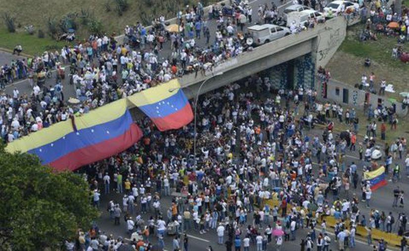La oposición venezolana postergó su marcha planeada contra Maduro. (AFP).