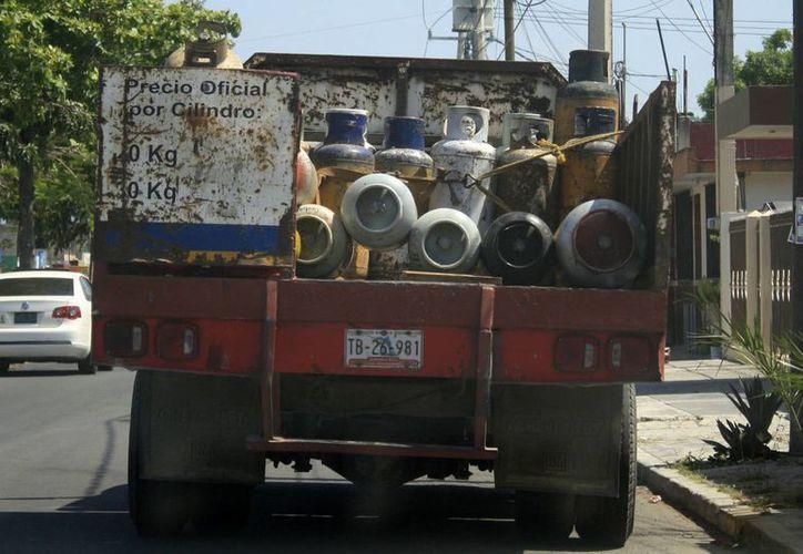 Repartidores roban de entre dos y cinco kilogramos de gas. (Redacción/SIPSE)