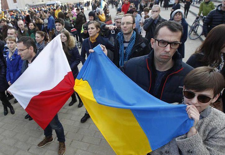 Países como Polonia y Letonia temen que la OTAN no ayude en caso de una invasión rusa. (Agencias)