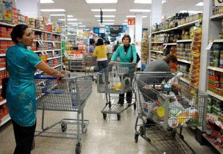 El 23% del gasto es destinado para la compra de alimentos. (Miguel Ángel Ortiz/SIPSE)
