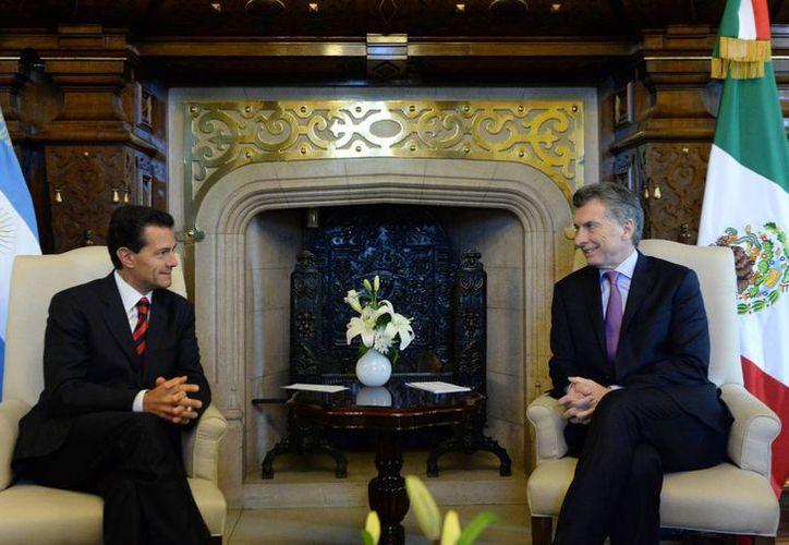 El presidente de México tuvo un encuentro con Mauricio Macri en la Casa Rosada, la residencia presidencial argentina. (Notimex)
