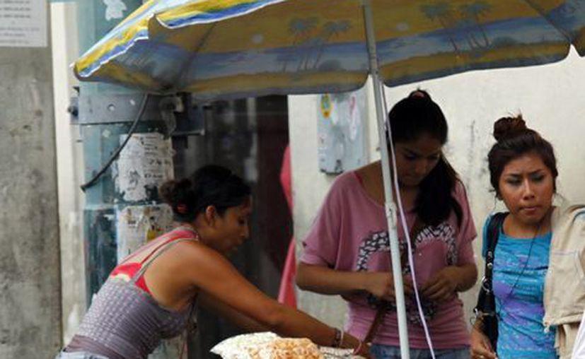 Ambulante en centro de Mérida. (Milenio Novedades)