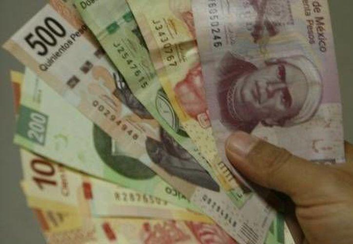 El ingreso corriente promedio trimestral por hogar pasó de 37 mil 574 pesos en 2010 a 38 mil 125 pesos en 2012. (Milenio)