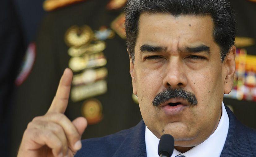 El presidente venezolano, Nicolas Maduro, habla durante una conferencia de prensa en el palacio presidencial de Miraflores en Caracas, Venezuela. (AP Foto/Matias Delacroix)