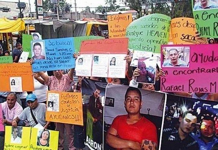 Las protestas populares por la desaparición de los jóvenes llevaron a su intensa búsqueda y posteriormente la de los responsables. (Agencias/Foto de archivo)