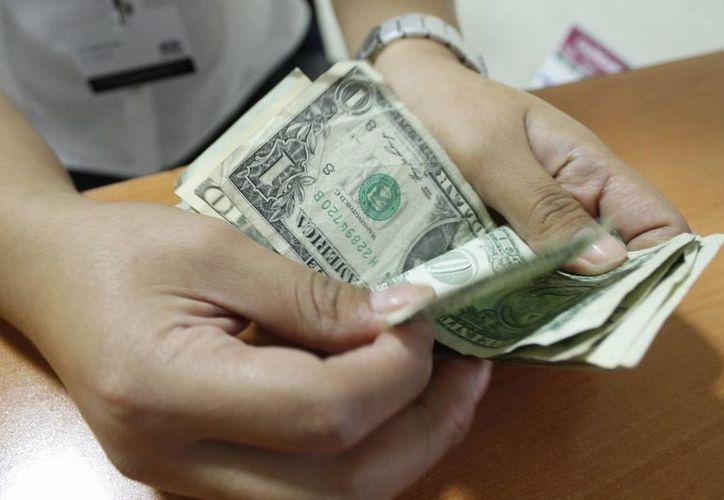 En el primer trimestre de 2014 el tipo de cambio estaba en 13.5 peso. (Israel Leal/SIPSE)