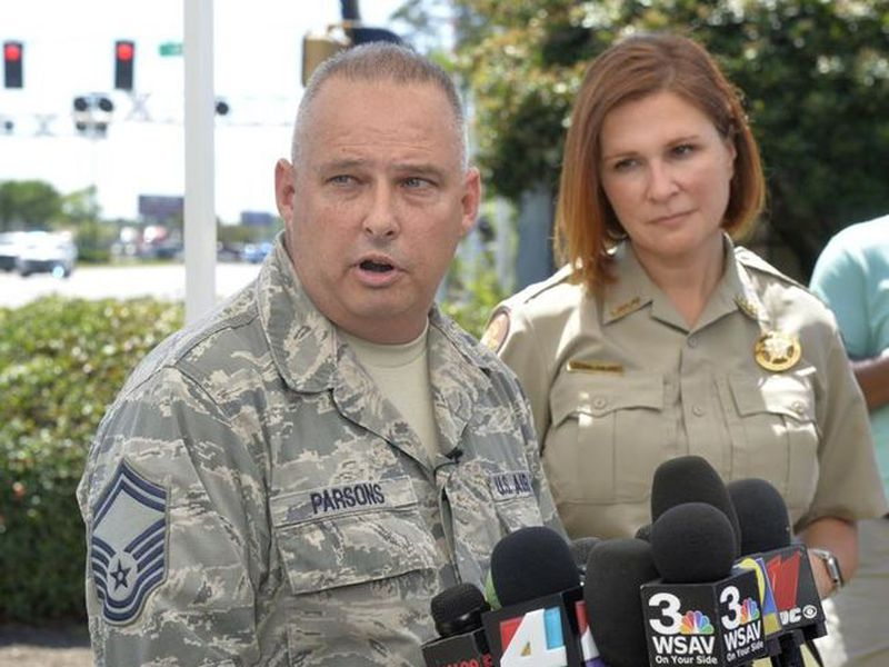 Sr. Master Sgt. Roger Parsons, left, with the 165th Airlift Wing conducts a press briefing near the site that a C-130 Hercules cargo plane crashed in Port Wentworth. (AP)