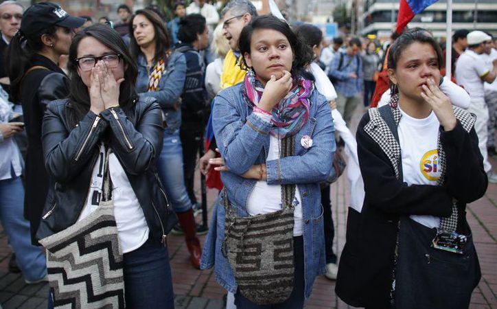 El reporte oficial indica que el No se impone con más de seis millones de votos. (AP/Ariana Cubillos)