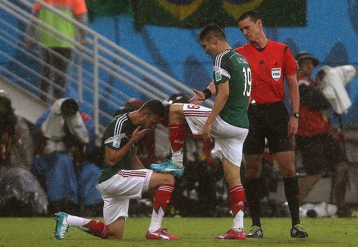 México va por su segunda victoria ante el anfitrión Brasil tras haber superado a Camerún en el Grupo A del Mundial. (Foto: AP)