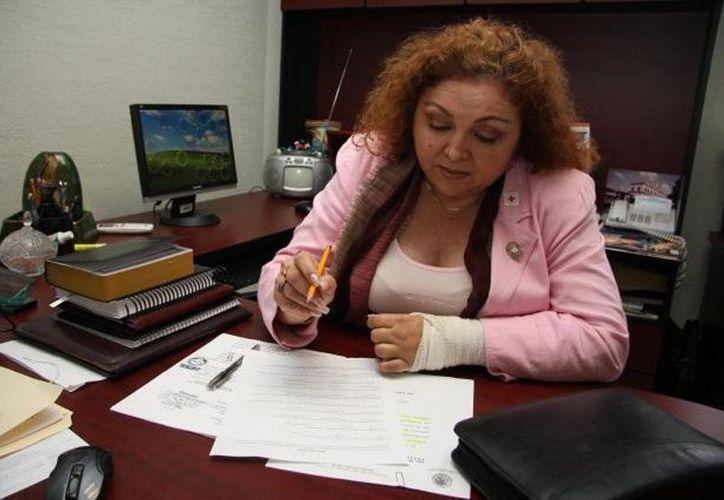 En septiembre, Doris Candila acudió a las oficinas del IMM y, en presencia de varias personas, entregó los 50,000 pesos con los que indebidamente se quedó al dejar el cargo. (sipse.com)