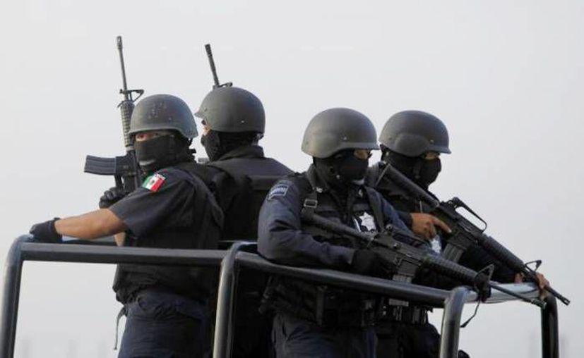 Vecinos aseguran que los federales custodiaban los vehículos al servicio de Los Zetas. (Imagen de contexto/Archivo/SIPSE)