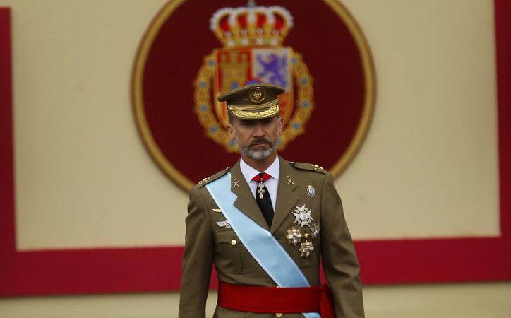 Felipe VI encabezó por tercera ocasión el desfile militar del 12 de octubre como rey. (AP/Francisco Seco)