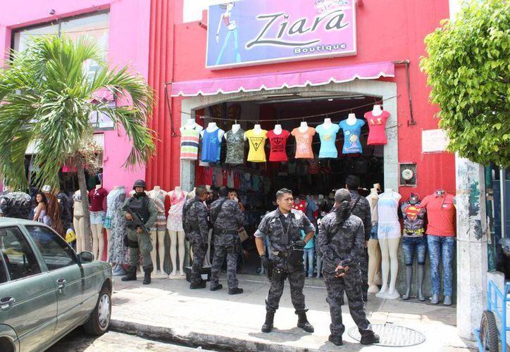 El operativo en Progreso tuvo como resultado dos tiendas cerradas y varios detenidos. (Milenio Novedades)